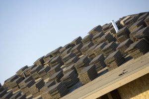 Close-up view of stacks of roof tiles on roof, construction site
